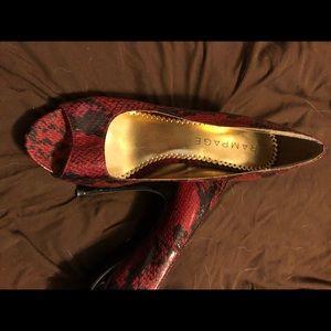 Black and red snakeskin peep toe heals.